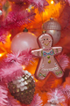 Unusual artificial Christmas tree decoration on pink fir branches, cute glass handmade toys - PhotoDune Item for Sale