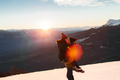 Young couple enjoying together. Having fun in snow at sunset in mountains - PhotoDune Item for Sale