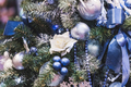 Christmas decoration with a lot small blue balls and decorative white roses - PhotoDune Item for Sale
