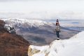 Woman with red hair  in black and white knitted cardigan watching an amazing mountain panorama - PhotoDune Item for Sale