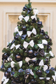 Christmas tree decorated in black and white style, with balls and bows - PhotoDune Item for Sale