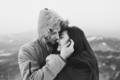 Teenager couple kissing hooded. Winter casual style, parka with fur hood - PhotoDune Item for Sale