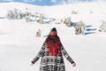 Woman with red hair in knitted cardigan and hat with bubo. Winter portrait in snowy mountains - PhotoDune Item for Sale