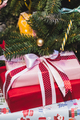 Beautiful boxes with gifts under a decorated Christmas tree - PhotoDune Item for Sale