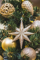 Christmas tree decorations in gold tones with lots of beautiful shiny balls and stars - PhotoDune Item for Sale