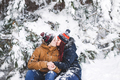 Сouple having fun and throwing snow in winter forest. A lot of snow around - PhotoDune Item for Sale