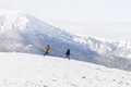 People having fun and running in mountains on the background of high snow-capped peaks - PhotoDune Item for Sale