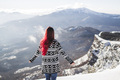 Woman in black and white knitted cardigan watching an amazing mountain panorama. Snow and sun - PhotoDune Item for Sale