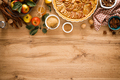Cooking Thanksgiving autumn apple pie with fresh fruits and walnuts on wooden background, top view - PhotoDune Item for Sale