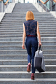 Slender stylish woman walking up a flight of stairs in town - PhotoDune Item for Sale