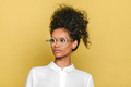 Trendy black girl in stylish retro round glasses with hair up - PhotoDune Item for Sale