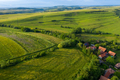 Flying over a village in Transylvania. Aerial drone view of Manastireni, Romania by drone - PhotoDune Item for Sale