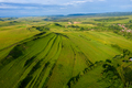 Aerial view of countryside vibrant green hills. Transylvania, Romania, drone point of view - PhotoDune Item for Sale