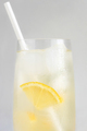 Close Up View of Glass of Lemonade with Paper Straw. - PhotoDune Item for Sale
