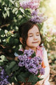 Vertical photo of little girl holding basket with blooming lilacs - PhotoDune Item for Sale
