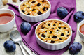 Plum cake on a wood background - PhotoDune Item for Sale