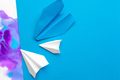 white paper airplane on a color block paper background - PhotoDune Item for Sale