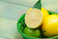 lemons and limes on a wooden background - PhotoDune Item for Sale