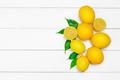 fresh lemons on wooden table. Creative photo - PhotoDune Item for Sale