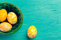 Yellow Easter Eggs On Wooden Background creative photo - PhotoDune Item for Sale