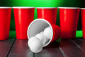 Cups for game Beer Pong on the table. creative photo - PhotoDune Item for Sale