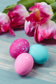 Easter eggs with tulips on blue wooden background - PhotoDune Item for Sale