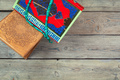 Colorful Koran with rosary on the wooden background. Holy book for Muslims for Ramadan concept - PhotoDune Item for Sale