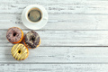 Glazed donuts on wooden background. creative photo - PhotoDune Item for Sale