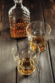 Whiskey glass and bottle on the old wooden table - PhotoDune Item for Sale