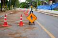 Under construction sign on the asphalt road - PhotoDune Item for Sale