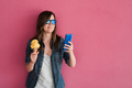 Happy girl using mobile phone while eating ice cream during summer vacation - Focus on woman face - PhotoDune Item for Sale