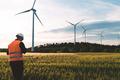 Engineer working at alternative renewable wind energy farm - Sustainable energy industry concept - PhotoDune Item for Sale