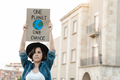 Demonstrator on the city protesting against climate change - Global warming and environment concept - PhotoDune Item for Sale