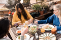Happy multiracial friends eating breakfast in restaurant outdoors during coronavirus outbreak - PhotoDune Item for Sale