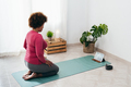 Black senior woman doing yoga class meditation at home with tablet- Sport and healthy lifestyle - PhotoDune Item for Sale