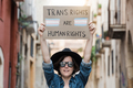 Trans hipster woman at gay pride holding transgender flag banner - Lgbt celebration event concept - PhotoDune Item for Sale