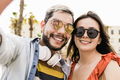 Happy hipster couple taking selfie during travel summer vacation outdoor in the city - PhotoDune Item for Sale
