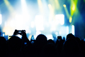Raised arms holding smart phones to recording a live concert - PhotoDune Item for Sale