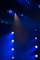 Stage lights glowing in the dark. Live music festival concept background - PhotoDune Item for Sale