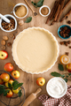 Cooking Thanksgiving autumn apple pie with fresh fruits and walnuts on wooden table, top view - PhotoDune Item for Sale
