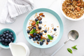 Blueberry and almond granola with greek yogurt, cottage cheese and fresh berries, top view - PhotoDune Item for Sale