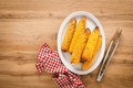 Grilled corn on the cob on wooden table, top view - PhotoDune Item for Sale