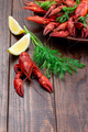 Red crayfishes on a plate served with dill and lemon - PhotoDune Item for Sale