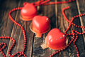 Red heart-shaped cake and red beads. Gift for Valentine's Day and Women's Day - PhotoDune Item for Sale