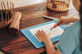 Girl cuts paper in half with stationery knife - PhotoDune Item for Sale