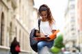 female university student reading notes outdoors - PhotoDune Item for Sale