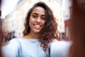 happy young indian woman taking selfie in city - PhotoDune Item for Sale