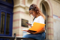 female college student with books and mobile phone - PhotoDune Item for Sale