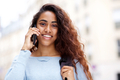 Close up young Indian woman talking with cellphone and smiling - PhotoDune Item for Sale