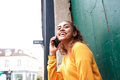 Close up side of happy young woman talking with phone - PhotoDune Item for Sale